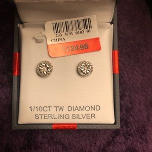 Sterling silver diamond studs.